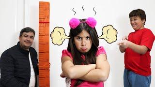 Maria Clara quer ser alta e pular no pula pula (kids wants to be taller & jump on a trampoline)