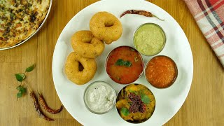 Top view shot of popular South Indian platter rotating on a wooden platform
