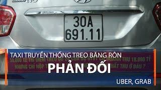 Taxi truyền thống treo băng rôn phản đối Uber, Grab | VTC1