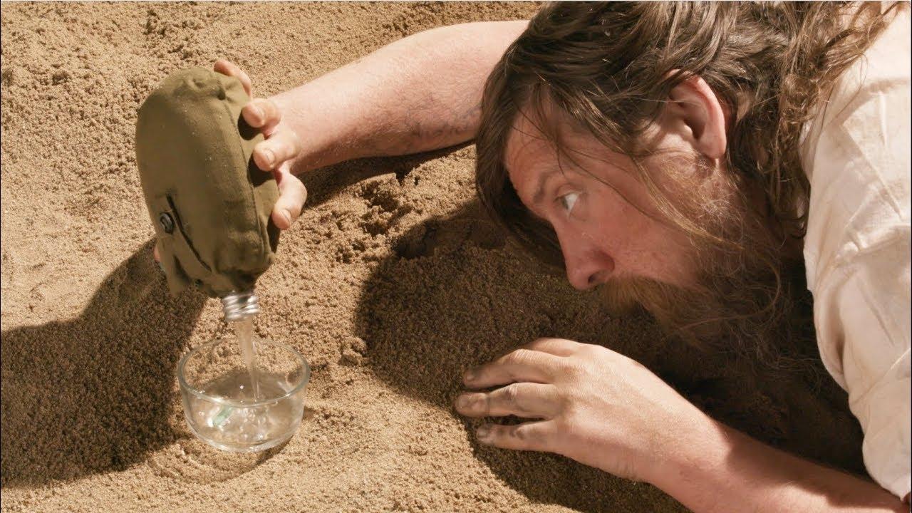 selfless-hero-man-stranded-in-desert-uses-last-of-his-water-to-wet-his-expanding-dinosaur-sponge