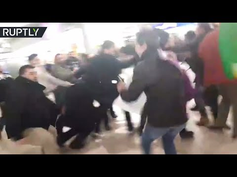 RAW: Turks vs Kurds mass brawl in Hannover Airport