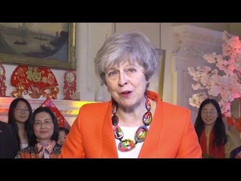 May says she cherishes China UK 'Golden Era' in New Year greetings