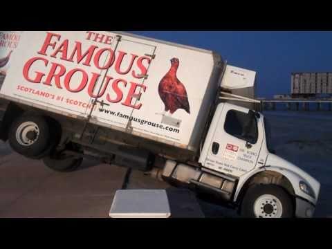Liquor truck rolls off seawall