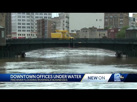 Rising Milwaukee River Flows Into Downtown Offices