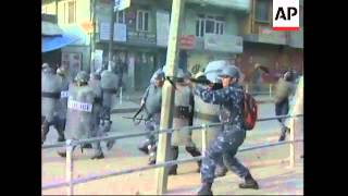 Protesters defy curfew, clash with police