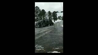 truck on icy hill hits stop light  -  981828 thumbnail