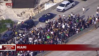 Justice for George Floyd protesters march on I-395 in downtown Miami