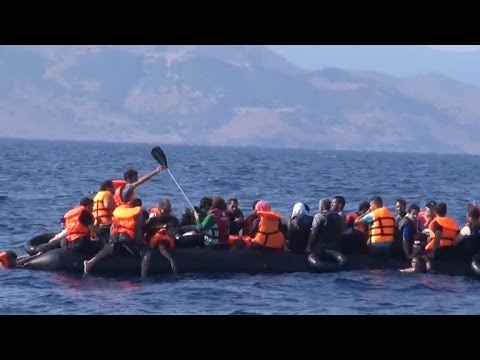Mystery men stop migrants trying to reach Greece