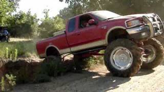 HUGE MUD TRUCKS FLEXING ACROSS GIANT RUTS - Silverado, F150, K5 Blazer and S10 4x4