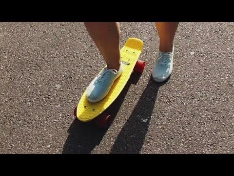Teenage Girl Feet Riding Short Modern Skateboard | Stock Footage