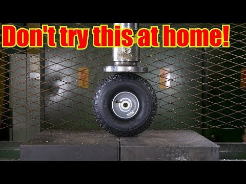 Crushing Over Inflated Tire with Hydraulic Press