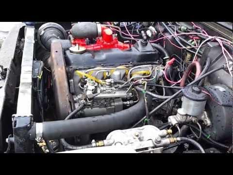 1966 Datsun 411 w/ Suzuki G13BB Engine Swap - Engine by Orange Claw
