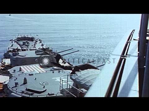 USS Worcester (CL-144) bombards North Korean coastline, Korea. HD Stock Footage