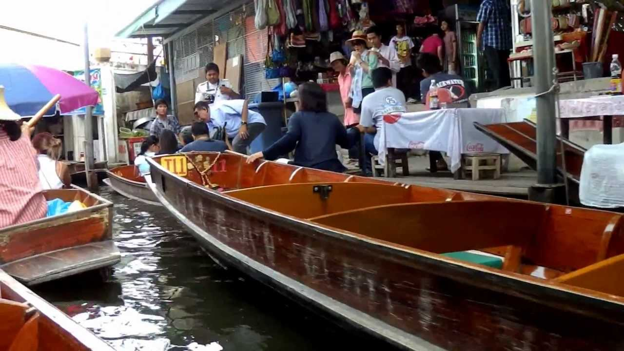 Riding A Wooden Paddle Boat At Damnoen Saduak Floating Market