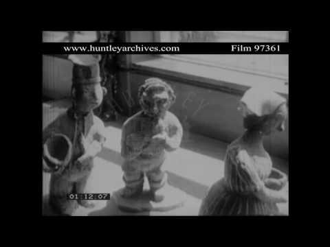 Teacher prepares classroom for pottery, 1960's.  Archive film 97361
