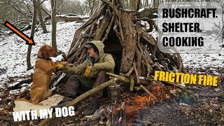 ABANDONED BUSHCRAFT SHELTER cooking - hand drill friction fire in the snow, with my dog AMBER