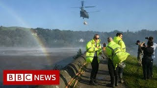 RAF called in as crews race to save damaged dam - BBC News