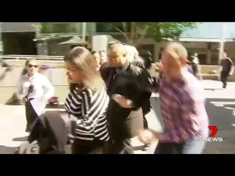 Clive Palmer & entourage clash with media outside court in Brisbane