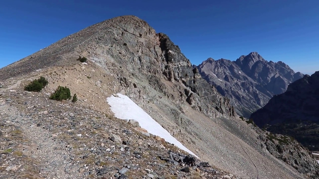 At the summit of Paintbrush Divide (10,700 ft) at roughly the halfway mark of completing the Paintbrush Canyon to Cascade Canyon Loop Hike in Grand Teton National Park.