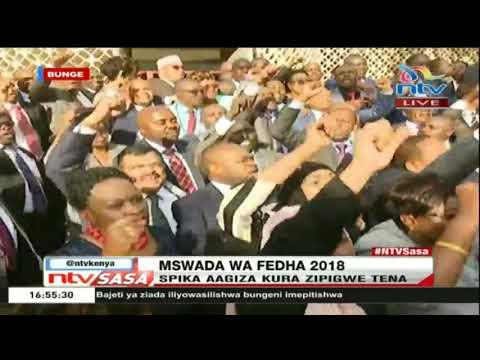 MPs ironically sing mambo mapambano as they match outside of Parliament