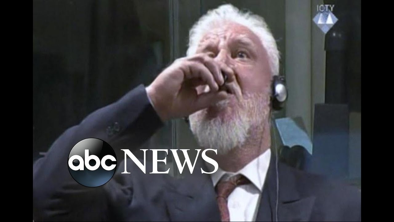 war criminal drinks poison in court