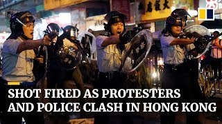Shot fired as protesters and police clash in Hong Kong