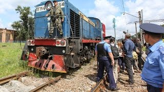 Train carrying bodies of Ukraine jet crash victims arrives in government-controlled city