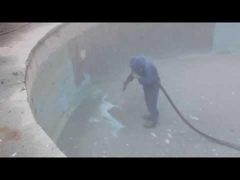 Sandblasting epoxy coating from concrete pool