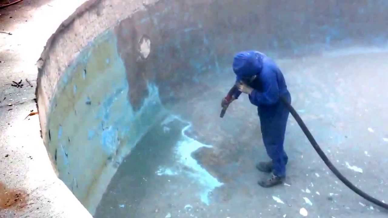 Sandblasting epoxy coating from concrete pool youtube for Epoxy coating for swimming pools