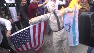 Palestinians burn Trump dummy to protest 'peace plan'