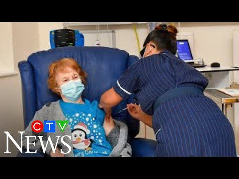 Moment patient gets first COVID-19 vaccine shot in U.K.
