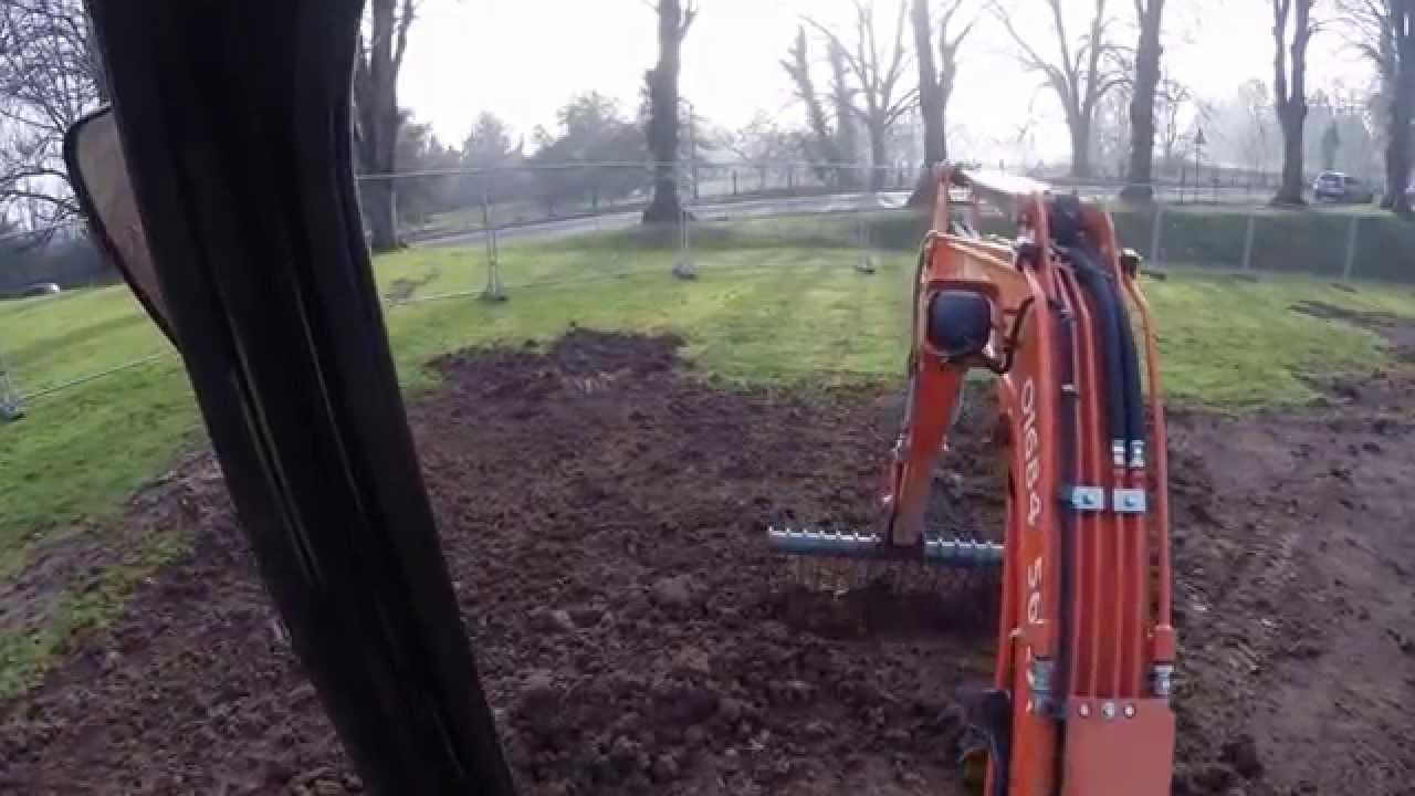 Kubota U25 3 Mini Digger Excavator Using A Rake