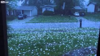 Baseball size hail smashes car window