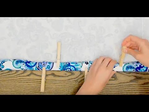 Wrap Fabric Around An Old Set Of Mini Blinds And Pinch With Clothespins For DIY Roman Shades