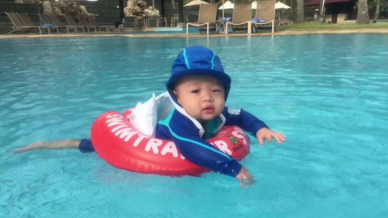 83eab5983b Eann Swimming with Swimtrainer float and Rip Curl Baby swim suit ...
