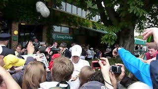 Roger Federer Great Close Up Signing Autographs at Wimbledon 2011