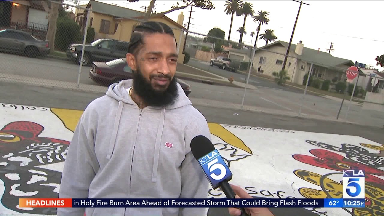 Rapper Nipsey Hussle gives back to local school