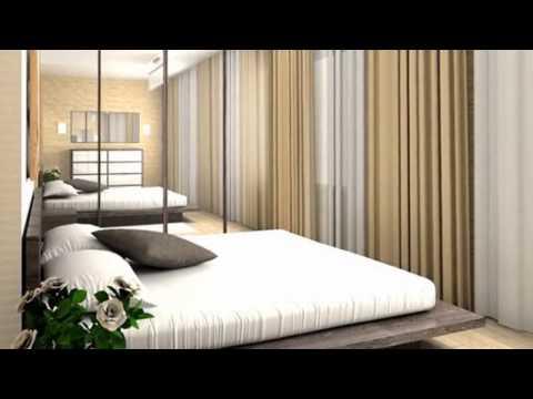 Большая кровать в интерьере маленькой спальни