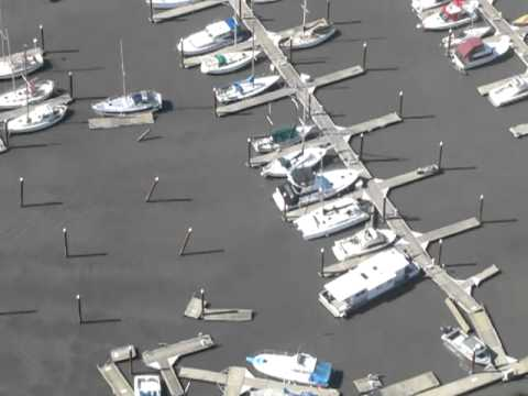 Tsunami aerial view of damage at the Port of Brookings Harbor