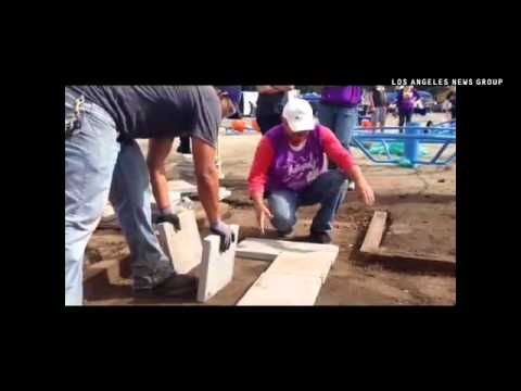 Volunteers gathered to build a dream playground for students at Environmental Charter Middle School