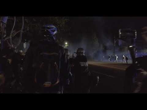 Download Portland riot cops gas and push protesters away from precinct
