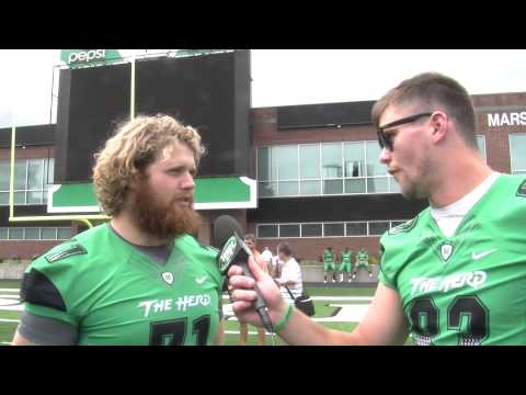 Marshall Football players interview each other at 2014 Herd Fan Day