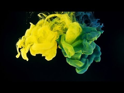 Yellow and Cyan Ink Splash on Black Background | Stock Footage - Videohive