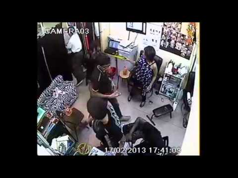 CCTV footage of fight at tattoo parlour