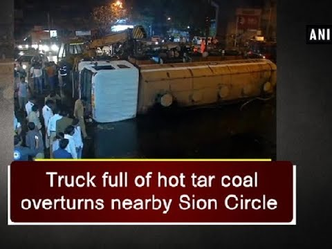 Truck full of hot tar coal overturns nearby Sion Circle - Maharashtra News