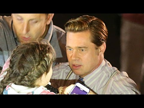 Brad Pitt Saves Young Fan From Being Crushed by a Crowd -- See the Pics!