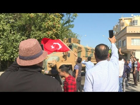 Crowd Welcomes Free Syrian Army Convoy In Turkish Border Town | AFP