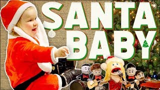 Смотреть клип Walk Off The Earth Ft. Baby Santa - Santa Baby