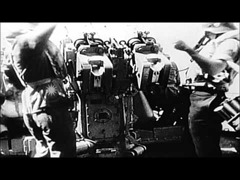 German navy sailors fire antiaircraft guns and prepare to submerge a submarine... HD Stock Footage