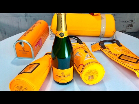 The Veuve Clicquot champagne insulated ice jacket, tote, mailbox, and Traveller with flutes